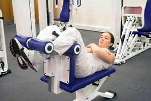 Girl performing the ending movement on an upper crunch ab machine