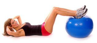 Girl performing an upper crunch using a ball